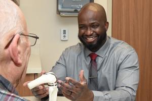 Dr. Gadina Delisca With Patient - Orthopedics